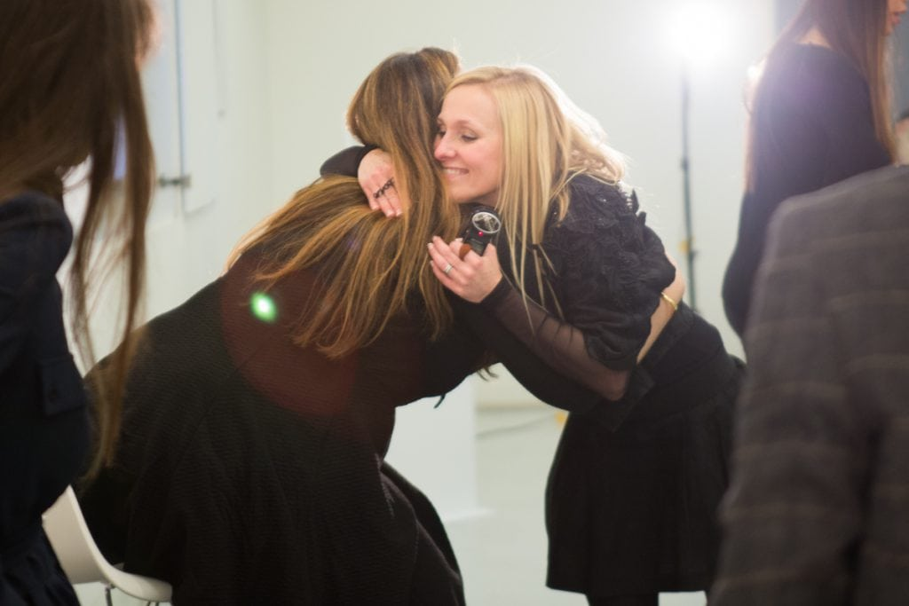 Mary Katrantzou & Courtney Blackman share an embrace post talk